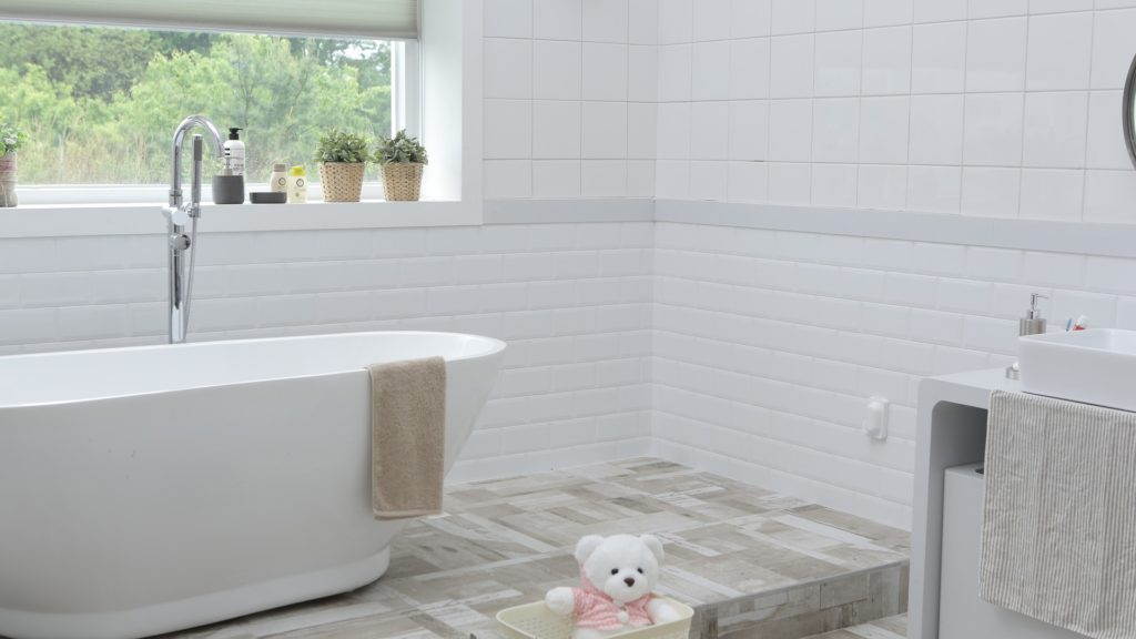 DIY Bathroom Repairs | Powell Realtors (showing a tiled bathroom with soaker tub)