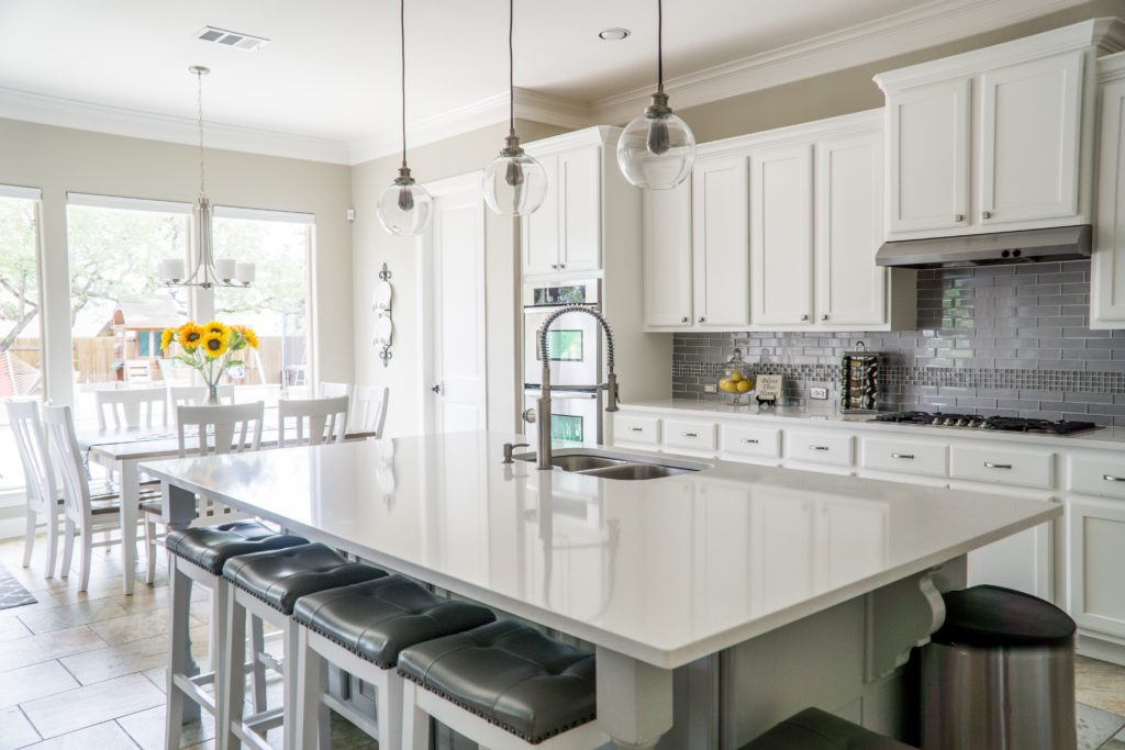 DIY Kitchen Repairs | Powell Realtors (showing a bright, modern white kitchen)