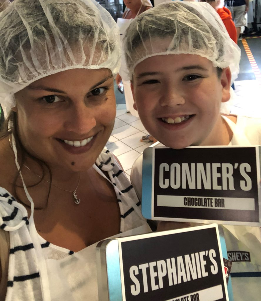 Stephanie Bryan, realtor with Powell Realtors, spends time with her stepson when she isn't working with Powell Realtors. Here, they enjoy a tour of a chocolate factory.