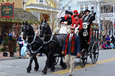 Horse drawn carriage with Christmas carol singers